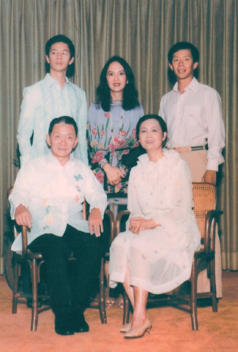 Wash with his wife, Anna Yu, and their three children.